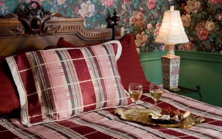 Bed in Parisian Room at Arch Cape Inn