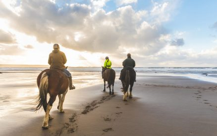 People horse riding in Cannon Beach