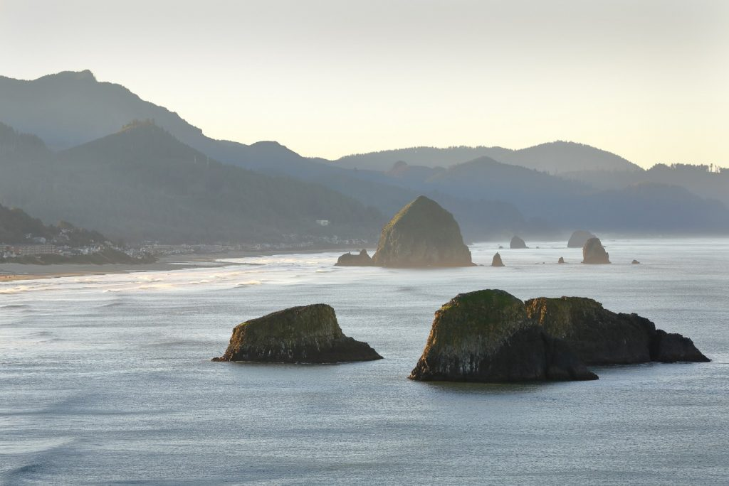 Aerial view of Cannon Beach rock formations in the misty morning light