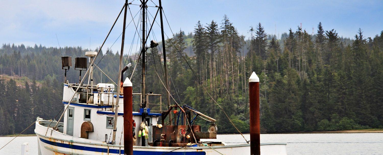 A fishing boat docked in harbor in Oregon | Fishing on the Oregon Coast